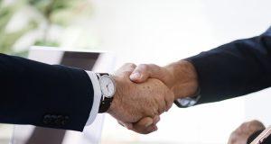 business man shaking hands together